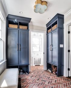 Blue and white mudroom with herringbone brick floor. What's not to love?