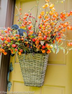 Gorgeous fall front door hanging basket by Four Generations One Roof