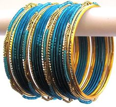 Blue and Gold Color Indian Belly Dance Costume Bangles Bracelet set of 24 Product Code :Indian Bangles Set 50 The Bangles Set Contains 24 individual Bangles Colors & Design: (As Per Images) Quantity: 1 Bangles Set Base Material : Alloy Metal and Age Group : Adult,Kids Price $USD   7.99