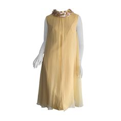 Beautiful 1960s Lisa Howard Canary Yellow Chiffon Babydoll Dress w/ Palliates | From a collection of rare vintage evening dresses at https://www.1stdibs.com/fashion/clothing/evening-dresses/