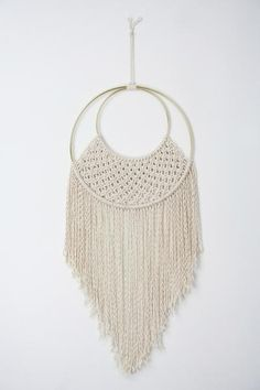 MADE TO ORDER hand knotted macrame wall hanging. Made with natural undyed cotton rope on brass rings. Ring width: 10 inchesLength from top of ring to bottom: approximately 24 inchesLength from nail to bottom: approximately 28 inches This macrame piece is made to order. Please allow 1-3 weeks from purchase date for your order to ship.