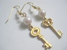 ANTIQUE Skeleton KEY EARRINGS - Matte Gold Tone Earrings - Pearl and Gold Earrings - Faux Pearl and Gold Tone - By FerryCreekVintage  Matte Gold Tone Non Matching Key Earrings feature round white faux pearl and French Hook closure for pierced ears. This fun and classic pair of earrings wears well with so many fashionable looks.