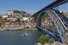 Portugal is one of the Top 10 Best-Value Destinations for 2015 according to Lonely Planet   A small yellow boat glides under the metallic Dom Luis I bridge over the Douro River in Porto, Portugal; the far bank has a cluster of white and yellow blocks of flats.