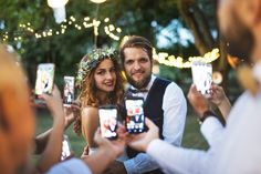 Guests with smartphones taking photo of bride and groom at wedding reception outside. by halfpoint. Guests with smartphones taking photo of bride and groom at wedding reception outside in the backyard. Wedding Blog, Destination Wedding, Wedding Photos, Dream Wedding, Wedding Day, Wedding Designs, Wedding Styles, Wedding Photography Checklist, Party Photography