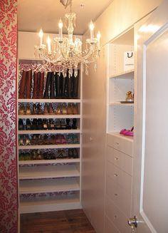 Glam feminine touches in a walk-in closet
