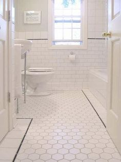 bathrooms - clean bathroom, white bathroom, white bathroom ideas, white hex tiles, white hex floor, subway tiled walls, hexagon tiles, hexag...