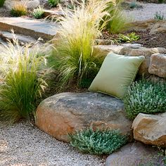 Set up a seat: mounding shrubs + soft grasses + sandstone boulders + one throw pillow
