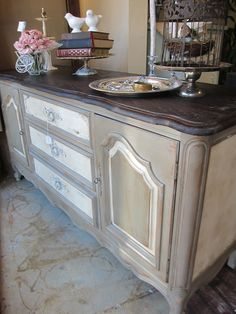 THIS I LIKE SO I CAN SHOW YOU THE TWO TONE OF THE DRAWER AND CABINETS. OVERALL IT IS TOO GREY, BUT THOUGHT IT WAS A GOOD ONE FOR THE OVERALL FEEL
