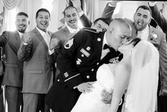 A fun idea to get some of the wedding party into a first kiss shot! Photo by: RVPhotography