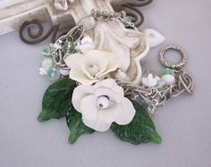love it! Repurposed Vintage Statement Bracelet, White Bead Charm Bracelet, Green Glass Leaves, Handmade Assemblage OOAK  Jewelry - JryenDesigns