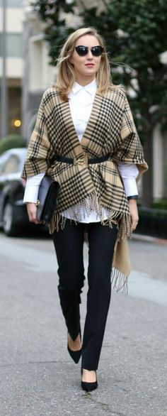camel and black plaid cape, classic white dress shirt, black trousers, black pointy toe pumps, belt with gold detail, clutch + sunglasses