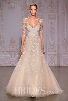 A great A-line wedding dress with a lot of gorgeous details by @m_lhuillier | Brides.com