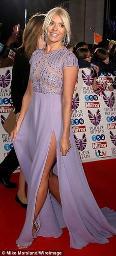 The This Morning host, 36, looked truly stunning in a flowing lilac gown, complete with saucy thigh-high split, while Nicole and Danielle commanded attention in equally plunging looks.