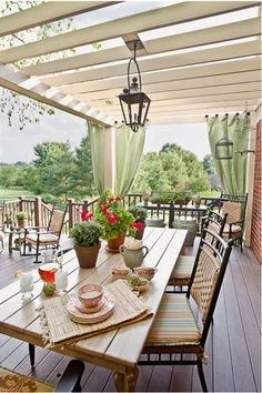 Deck With Pergola and Outdoor Curtains...love curtains hanging on individual knobs at the corners