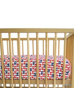 Designed for little dreamers, this charming crib sheet features soft, quilted cotton construction and a fun, reversible print.