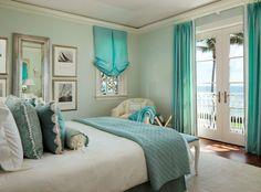 Tranquil aqua ocean view bedroom.
