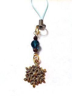 Golden snowflake cell phone charm with two tone by BeadingByJenn, $7.00 #phonecharm #snowflake #christrmas #winteraccessories #emeraldgreen #pursepull #zipperpull #handmade #etsy #wanelo