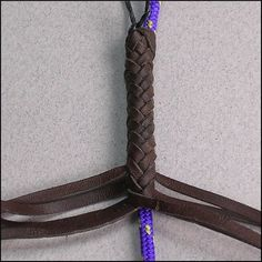 Eight Strands Square or Herringbone - In this example I'll introduce braiding around a core which will make this a Herringbone braid rather then a Square braid. Start by crossing the four inside strands as pictured.