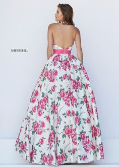 Have fun at your senior prom with this exquisite Sherri Hill prom dress  Ball gown features a halter neckline with a plunging bustline and net ins.