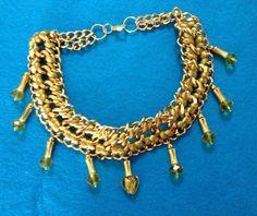 collar dorado con briollet de swarosvki