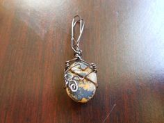 Natural toned stone metal wrapped with wire.. $10.00, via Etsy.
