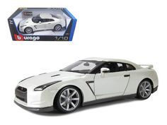 2009 Nissan GT-R R35 Pearl White 1/18 Diecast Model Car by Bburago - Brand new 1:18 scale diecast model of 2009 Nissan GT-R R35 die cast model car by Bburago. Has steerable wheels. Brand new box. Rubber tires. Has opening hood, doors and trunk. Made of diecast with some plastic parts. Detailed interior, exterior, engine compartment. Dimensions approximately L-10.5, W-4, H-3.5 inches. Please note that manufacturer may change packing box at anytime. Product will stay exactly the same.-Weight…