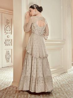 Beige Golden Embroidered Peplum Style Anarkali Gown is specifically designed to make you look perfect as a bride and bridesmaids. This suit set features zari and resham thread embroidered detail on. Anarkali Tops, Anarkali Lehenga, Anarkali Suits Online Shopping, Floor Length Anarkali, Lehenga Style, Indian Gowns Dresses, Printed Gowns, Bridal Dress Design, Engagement Dresses