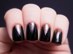 Black and glitter 'V' manicure