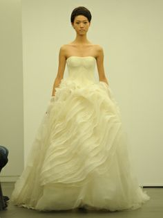The bodice style on this Vera Wang gown will give you lots of structure and support (not to mention, its super flattering!).