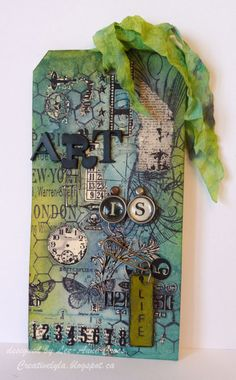 Art is Life; Decided to play along with the Tim Holtz 12 tags of 2013 and did the May tag.