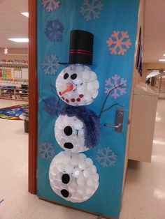 Snowman door decoration - dubbed Mr. Sparkles by my students. Made from Styrofoam cups hot glued together. Used 2 1/2 packages of cups. It was time consuming but turned out great!