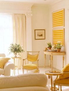 BHG Golden Yellow accents give very neutral room a sunny glow and look at that simple art over the demilune table.