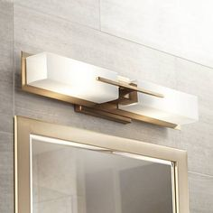 Illuminate a vanity area beautifully with this 2-light bath light in a burnished brass finish.