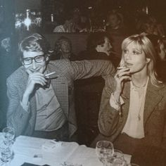 Betty Catroux and Yves Saint Laurent at dinner. 1980s