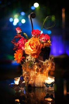 Similar to branches, stumps are creative replacements for expensive vessels and leave more funds for flowers. Showorks dresses up the humble tree trunk with vibrant roses and gerbera daises.   Photo: Courtesty of Showorks