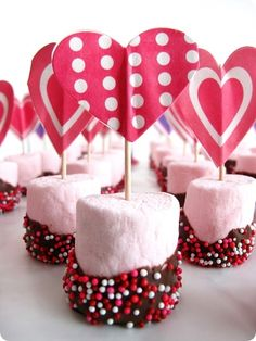 Super simple Valentine's treat: pink marshmallow dipped in melted chocolate then sprinkles + heart shaped paper toothpick.