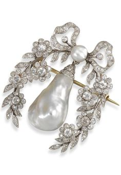 A late Victorian natural pearl and diamond foliate brooch, suspending a large drop shaped natural pearl from a smaller pearl centred bow and floral surround. Millegrain set overall with graduated circular and cushion shaped diamonds. Detachable brooch fitting. #Victorian #brooch