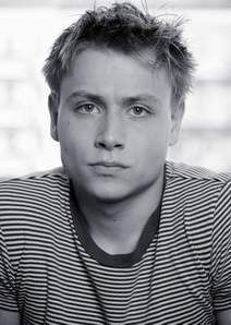 Max Riemelt as Andrei.  The young German version. Notice the long suffering expression he is giving Lyrik when she takes his picture.