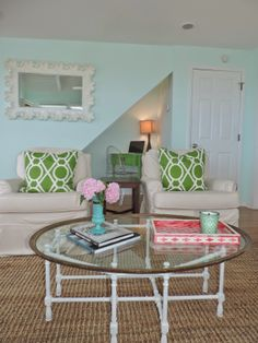 Bright HomeGoods accessories style this vintage coffee table and add pops of color and function to this beach house.  #sponsored