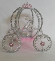 Grand Carriage These carriages are 100% handmade with good quality raw materials, the carriage is wire formed adorned with color pearls, tulle, acrylic gemstones, acrylic crystal, a lovely acrylic slipper adorned with a little bling, rhinestone buttons on wheels and a stunning rhinestone