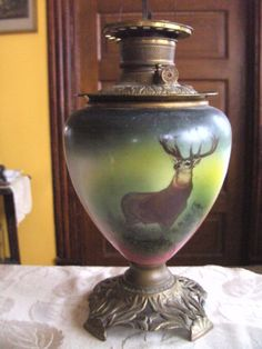 elk lamp without globe....wow that's gorgeous. Have one just like this, but it has the top globe.