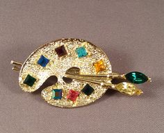 Gold Vintage Artist Palette Brooch with rhinestone accents - blue, yellow, gold… Jewelry Art, Jewelry Accessories, Fashion Accessories, Vintage Brooches, Vintage Jewelry, My Art Studio, Green And Purple, Blue Yellow, Beads And Wire