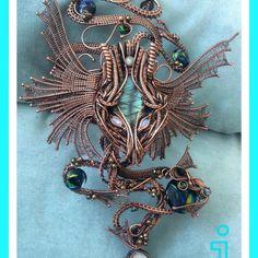 Copper dragon arm cuff.