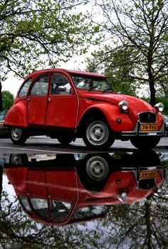 'Red Citreon ~ I remember seeing these when I was in Germany several years ago, Such cool cars.' said previous pinner • Citroen 2CV