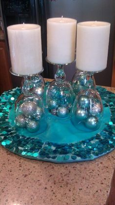 Wine glass centerpiece with Christmas ornaments