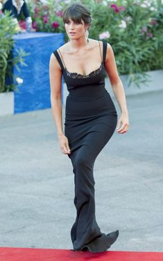 Gemma Arterton wears a black fitted Stella McCartney gown with a lace bra…