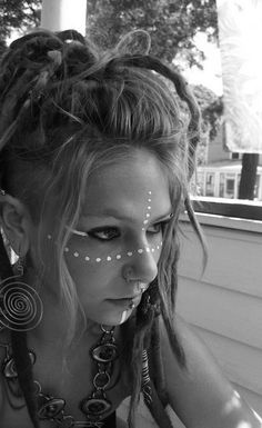Sweet dreads and inspiration for tribal face makeup.