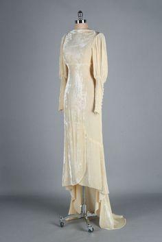 Wedding Dress: ca. 1930's, silk velvet, train, Juliette sleeves with covered buttons, bias cut, empire waist.