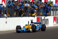 F1   2003: Fernando Alonso acknowledges his Renault teammates on the pit wall as he seals his first-ever F1 victory.