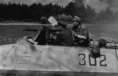 "5sswiking: "" Wiking Division officers fire an MG 42 machine gun mounted on a Sd.Kfz. 251 command vehicle during a possible firefight with Soviets in Eastern Poland, July 1944. """